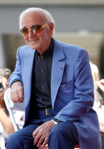 FILE PHOTO: Armenian-French singer Aznavour sits before unveiling his star on the Hollywood Walk of Fame in Los Angeles